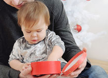 Portrait of cute little baby girl with her father near Christmas Stock Photos