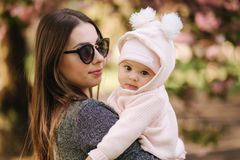 Portrait of cute little baby girl outside with mom. Beautiful girl smile. Five month baby. Happy family royalty free stock image