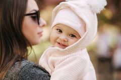 Portrait of cute little baby girl outside with mom. Beautiful girl smile. Five month baby. Happy family royalty free stock photography