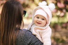 Portrait of cute little baby girl outside with mom. Beautiful girl smile. Five month baby. Happy family stock photos