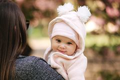 Portrait of cute little baby girl outside with mom. Beautiful girl smile. Five month baby. Happy family royalty free stock photos