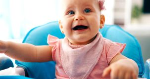 Portrait of cute little baby girl with pink bow flower stock photography