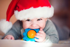 Portrait of cute little baby in red  Santa Claus hat Stock Photos