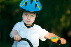 Portrait of cute little boy in a bicycle Stock Photo