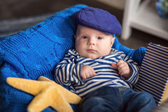 Portrait of a cute little boy in a cap and vest Stock Image