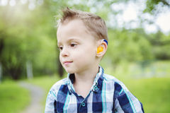 Portrait of cute little boy child outdoors on the Stock Image