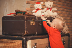 Portrait of a cute little boy among Christmas toys Royalty Free Stock Images