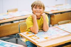 Portrait of a cute little boy in a classroom royalty free stock photography