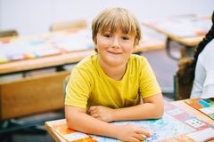 Portrait of a cute little boy in a classroom stock photography