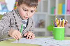 Little boy drawing with pencil. Portrait of cute little boy drawing with pencils Royalty Free Stock Image