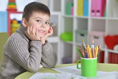 Little boy drawing with pencil. Portrait of cute little boy drawing with pencils Stock Photos