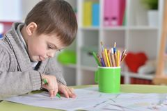 Little boy drawing with pencil. Portrait of cute little boy drawing with pencils Stock Photo