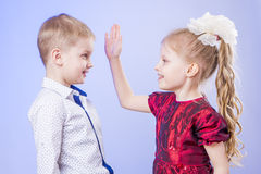 Portrait of cute little boy and girl having fun Royalty Free Stock Images