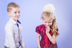 Portrait of cute little boy and girl having fun Stock Images