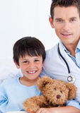 Portrait of a cute little boy and his doctor Royalty Free Stock Photography
