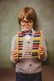 Portrait of cute little boy holding abacus Royalty Free Stock Photos