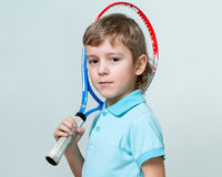 Portrait of a cute little boy holding a tennis  racquet Royalty Free Stock Image