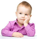 Portrait of a cute little boy looking at something stock image