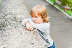 Portrait of a cute little boy. Outdoor portrait of a cute toddler boy Stock Images