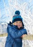 Portrait of cute  little boy outdoors on cold winter day. Happy boy during winter vacations Stock Photos