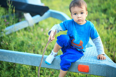 Portrait of cute little boy playing on the grass Royalty Free Stock Images
