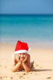 Portrait of cute little boy in Santa hat Royalty Free Stock Photography