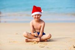 Portrait of cute little boy in Santa hat Stock Photo