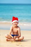 Portrait of cute little boy in Santa hat Stock Photo