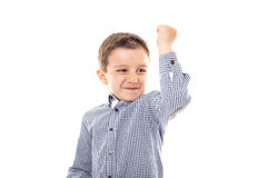 Portrait of a cute little boy showing  his biceps  muscle Stock Image