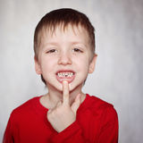 Portrait cute  little Boy shows the First dropped-out milk Tooth Royalty Free Stock Image