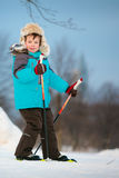 Portrait of cute little boy skiing on cross Royalty Free Stock Photo