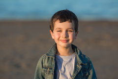 Portrait of a cute little boy smiles in denim in the evening Royalty Free Stock Photos