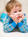 Portrait of a cute little boy. Supporting his head with hands Stock Photo