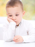 Portrait of a cute little boy. Supporting his head with hands Royalty Free Stock Image