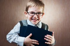 Portrait of cute little boy. In tie and glasses stock image