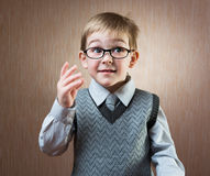 Portrait of cute little boy. In tie and glasses royalty free stock photos