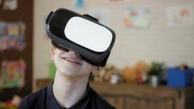 Portrait of a cute little boy wearing virtual reality headset stock video