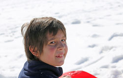 Portrait of a cute little boy in winter in the mountains Stock Images