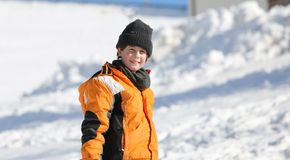 Portrait of a cute little boy with wool cap and winter jacket in Stock Image