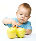 Portrait of a cute little boy with yellow apples Stock Photography