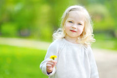 Portrait of cute little cheerful girl outdoors stock photos