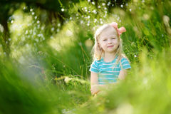 Portrait of cute little cheerful girl outdoors stock photo