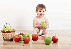Portrait of a cute little child with apples royalty free stock photos