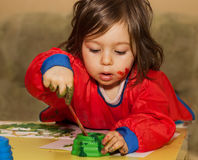Portrait of Cute little child drawing and studying at daycare. Portrait of pretty little child drawing and studying at daycare stock images