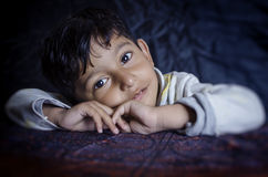 Portrait of cute little child folded hands royalty free stock photography