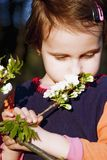 Portrait of cute little child girl in blooming garden. Concept o Royalty Free Stock Images