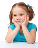 Portrait of a cute little girl. Holding her face with hands, isolated over white Stock Images