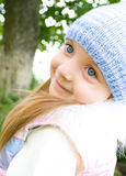 Portrait of a cute little girl. Spring portrait of a cute little girl outdoors Stock Photos