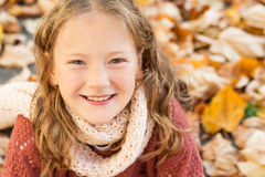 Portrait of a cute little girl. Autumn portrait of a cute little girl with curly hair, having fun outdoors on a nice sunny day Royalty Free Stock Images