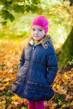 Portrait of cute little girl in autumn park Royalty Free Stock Photos